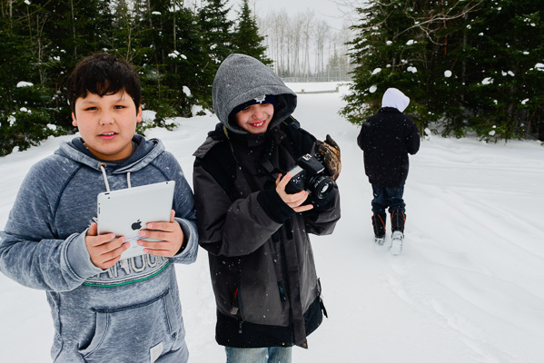 "Constance Lake First Nation students learning traditional ecological knowledge documentation skills during a Shared Value Solutions audio-visual training workshop on the topic of ""What Water Means to Me"""