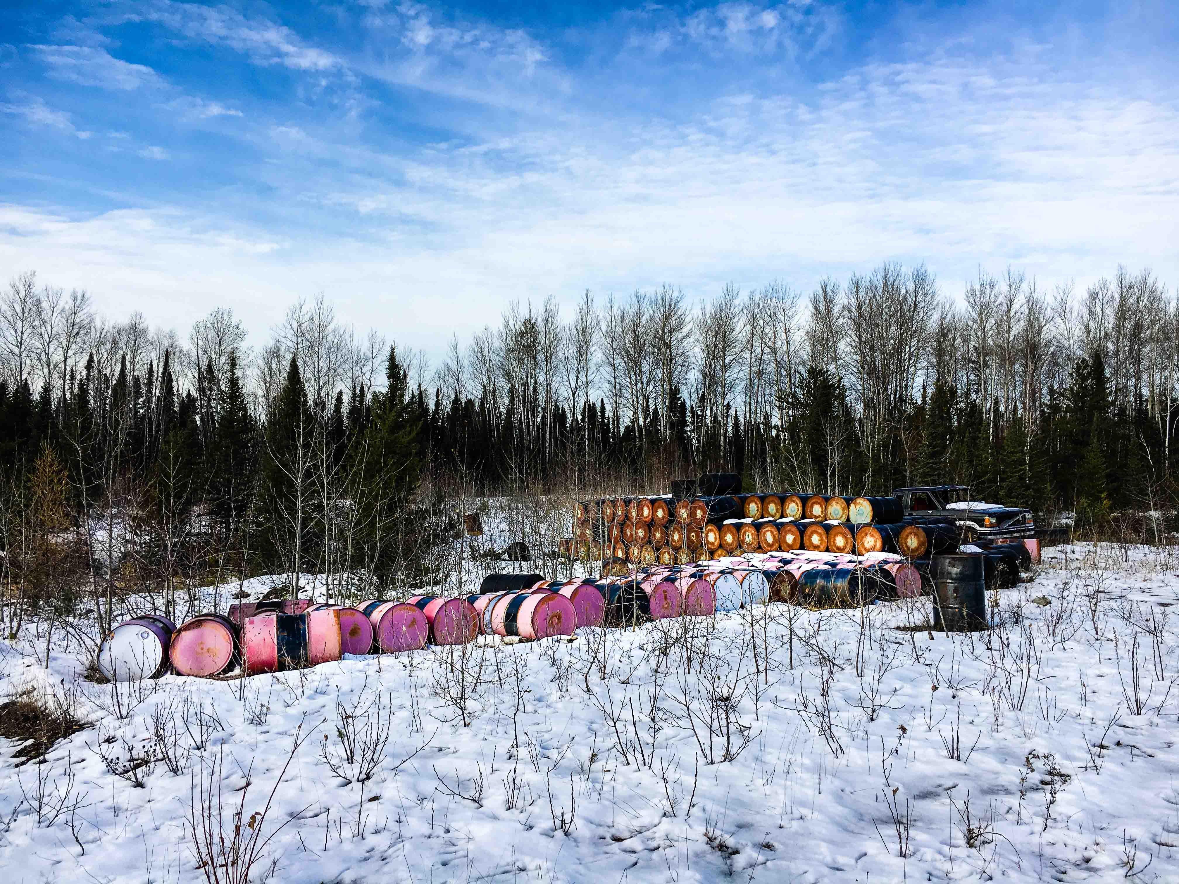 Barrels left at an abandoned mine exploration site